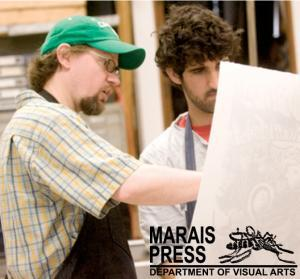 Brian Kelly working with a printmaking student
